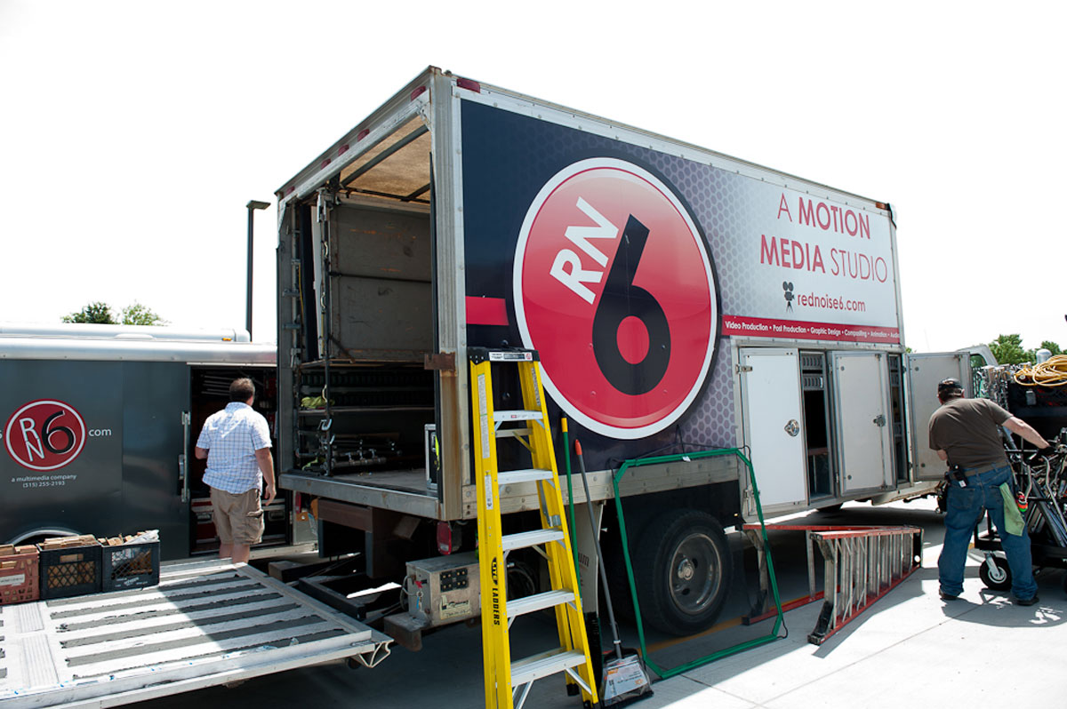 A Red Noise 6 truck gets unloaded by a crew of video production employees.